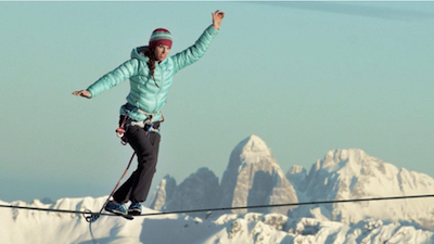 Hayley Ashburn on a highline in the Italian Alps. Click the image to see the video on Vimeo.